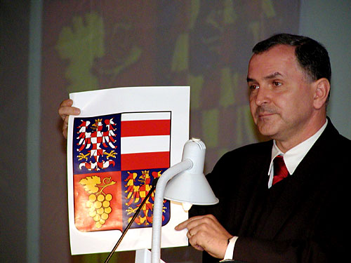 Ing. Stanislav Juranek, Governor of South Moravia, showing Moravian coat-of-arms and explaning its symbols of peace and mutual coexistance